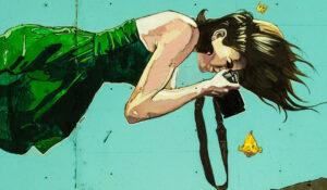 donna fotografa murales